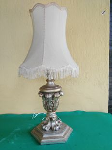 Wooden lamp carved and mecca-silvered with original shade in fringed fabric, from the early 1900s