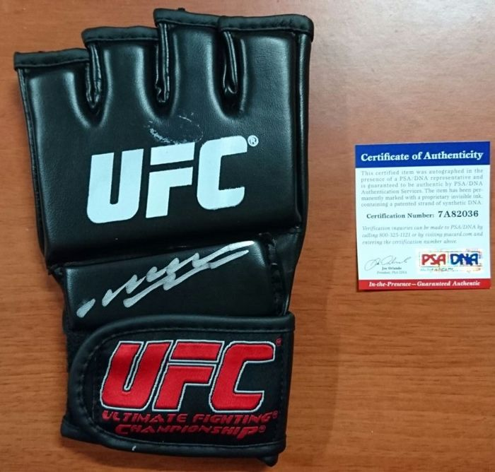 Original UFC glove with the signature of Spider Anderson Silva and her JSA certificate of authenticity