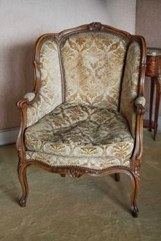 Old armchair in Louis XV style, velvet with floral designs