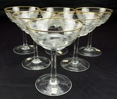 Set of six champagne/sparkling wine flutes made of pure crystal with gold thread
