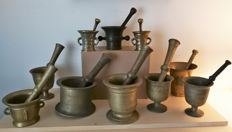 Group of ten antique pestle & mortars with original pestles, 19th to 20th century