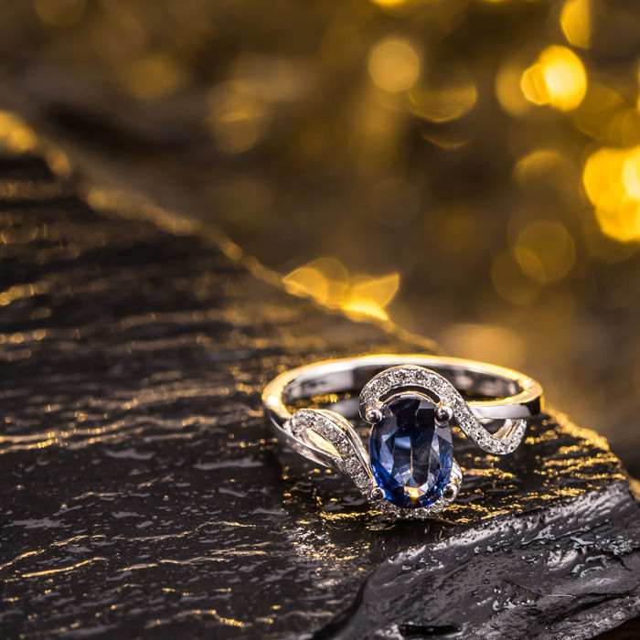 Sapphire, diamond, 18K gold ring. Gem weight: 1.39 ct.