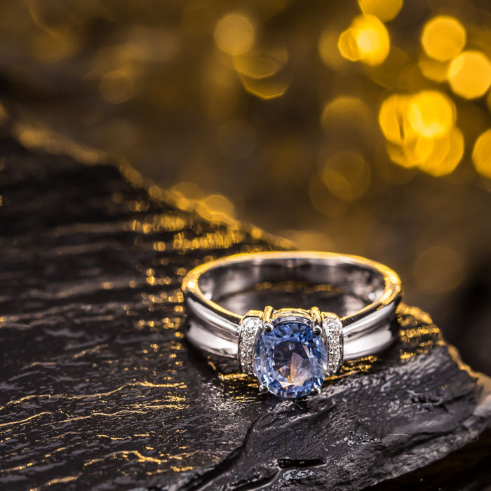 Sapphire, diamond, 18K gold ring. Gem weight: 1.24 ct.