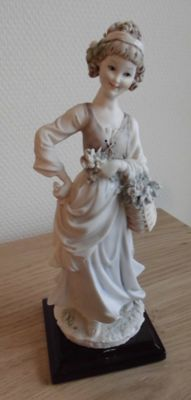 Porcelain sculpture by Capodimonte - Shepherdess with flower basket