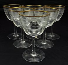 Set of six wine glasses made of pure crystal with gold thread