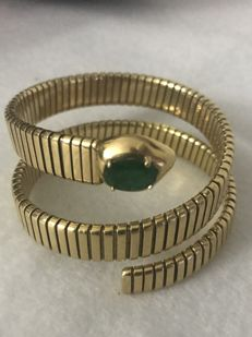 Elastic bracelet in 18 kt gold with emerald of 2.50 ct