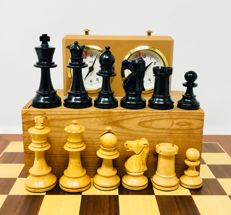 Lardy wooden chess with clock and board.