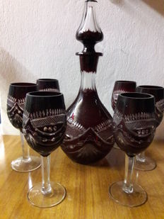 Wine decanter and glasses in dark red cut crystal