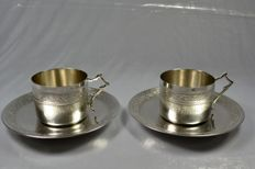 Pair of sterling silver cups and saucers, France, circa 1905