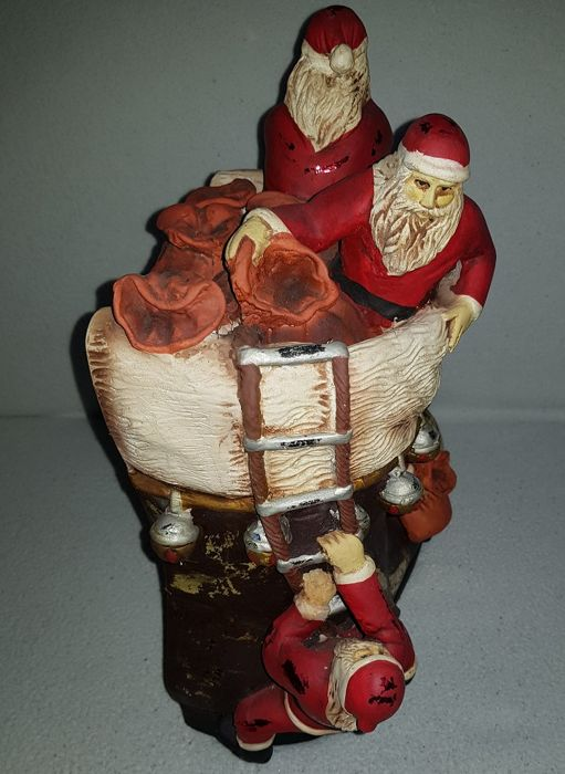 Santa Clauses who climb a Shoe - Christmas decoration with Father Christmas