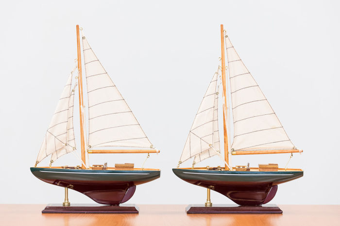 Two wooden models of a cutter