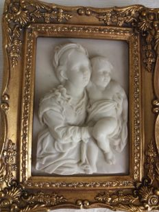Biggs & Sons - plaque depicting a mother and child in alabaster powder and relief