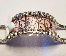 Christian Dior - Vintage plated pink enamel & 'en tremblant' paste white flower with swarovski crystal bordered bracelet