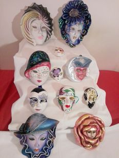Eleven decorative ceramic Venetian masks of several size