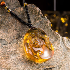 Amber pendant from Burma, hand carved into the shape of fish and lotus, weight: 26.8 grams