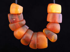 11 Antique natural amber beads. West african trade