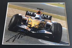 Nice framed image, personally signed by Fernando Alonso