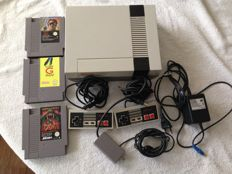 Nintendo Entertainment System Incl 2 controller all cables and 3 games : Power Blade, Low G Man and Swords and Serpents