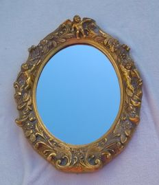 Gold-plated mirror with floral and garland decoration, antique look plastic.