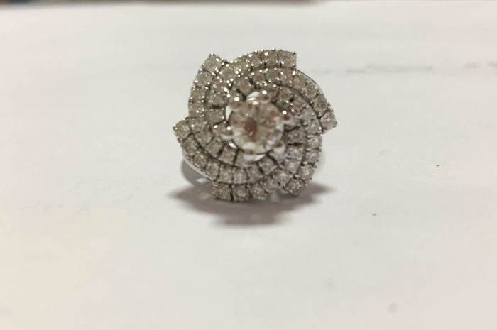 Handmade 18 kt white gold ring with diamonds 0.56 ct main stone and 1.02 ct accent stones. Total carat weight 1.58 ct.