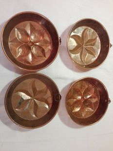 4 antique copper pudding moulds, 1970s