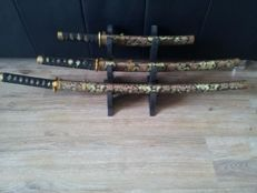 Three-piece set of decorative swords on a holder - China - late 20th century