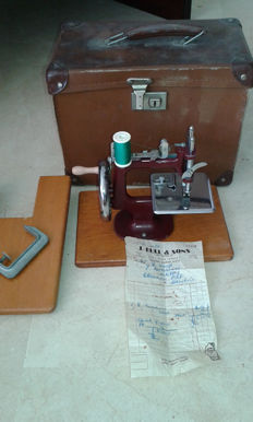 1950s vintage mini sewing machine,J Bull & Sons ,original box, and purchase receipt.