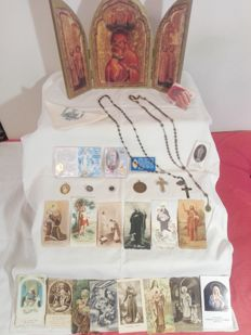 Interesting lot of various religious items: an icon, holy cards and medals, etc.