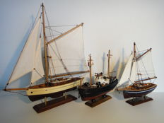 Fishing boat and two Sailboats - well built wooden model boats.