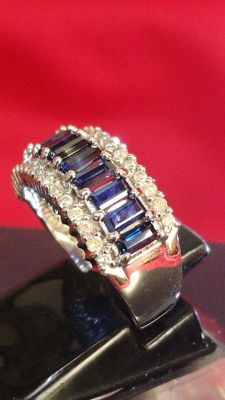 Wonderful white gold ring with 11 sapphires total: 1.32 ct and 30 natural diamonds total: 0.36 ct, IGE certificate.  Low reserve price.