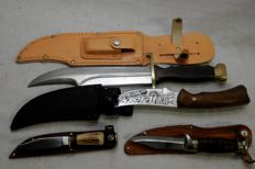Lot of 4 hunting knife include Crocodile Hunter bowie  knife   and 3 other knife made in united kingdom .