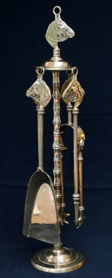 Hearth set of copper with horse heads and stand in artificial bamboo - France - approx. 1960
