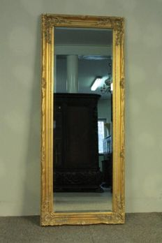 Baroque mirror in beautifully decorated golden frame, 134 x  54 cm