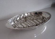 Silver plated dish with grid:  Roast-serving tray and/or asparagus-serving tray.