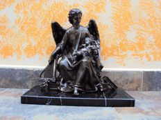 Angel holding baby Jesus - bronzed metal on a black marble base - France - late 19th century