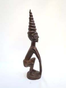 Wood stylized sculpture of a man