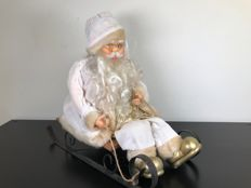 Beautiful finely decorated white Santa Claus on a sled, late 20th century