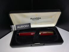 Aurora fountain pen in burgundy resin and gold plated finishing, complete with original converter. Unsold stock, never used, with box