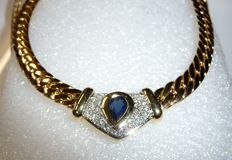 Necklace choker made of 585 / 14 kt gold 42-43 cm long with 1 ct sapphire droplet + 0.50 ct. Diamonds