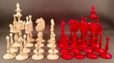 "A ""Selenus Pattern"" polished bone chess set, Germany, early/mid 19th century"