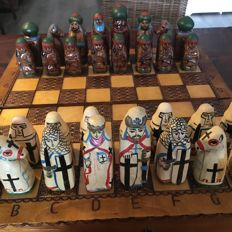 Chess set, theme Greek Orthodox Church against the Moors in wooden folding box