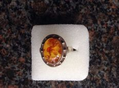 Silver ring with large oval amber