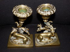 Two brass candlesticks with reclining deer