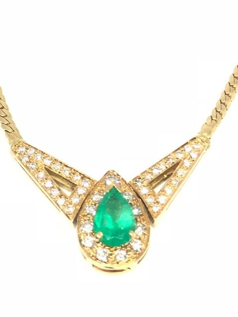 Necklace in 18 kt yellow gold with diamonds and emerald