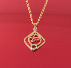 18 kt.  Gold necklace and Pendant decorated with 13 zircons, total weight - 5.06 g
