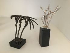 "Two Burnished Sculptures: ""Vele Handen"" and ""Samen"""