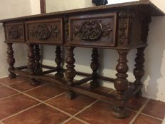 Table with drawers in walnut wood with turned legs in 17th century Spanish style, c. 1900