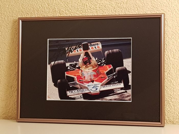 Emerson Fittipaldi - World champion Formula 1 - hand signed framed photo Eau Rouge Spa + COA.