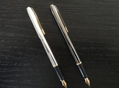 Elysee fountain pens: Steel shiny ribbed and dark mat steel. Has never been used.