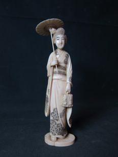 Ivory okimono of a lady with parasol - Japan - circa 1900